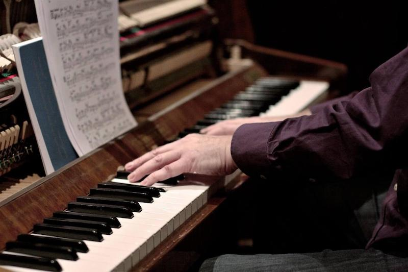 Egor in his studio where he teaches jazz piano lessons his Calgary studio